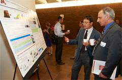 Viewing posters featuring University of Minnesota Research during the Energy Storage Summit